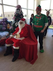 Santa (Jack Corrao) and Elf(Tyler Kiel) supporting ENF at Childrens Hospital during the Holidays